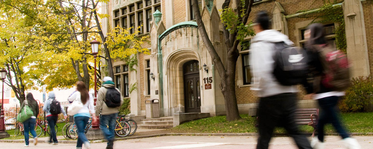 Students and professors briskly pass Hagen Hall located on Séraphin-Marion Street, one of campus' main pedestrian arteries.