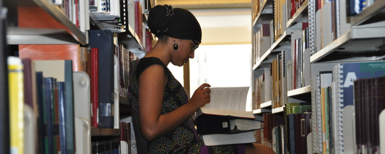A student reads at the library